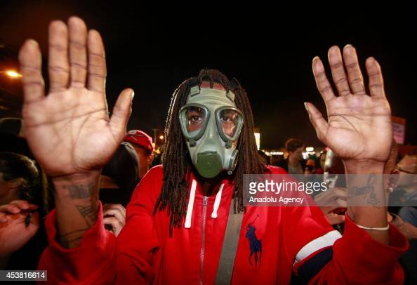 A protester raises his hands as the protests in the Missouri city of Ferguson over the death of Michael Brown continue in Ferguson United States on...