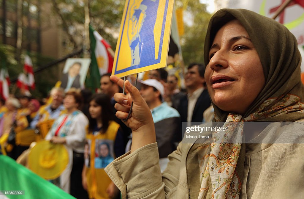 Protester Rani ,who didn't give her last name, attends a rally of groups opposing Iranian President Ahmadinejad's speech at the United Nations General Assembly on September 26, 2012 in New York City. Politicians including former New York Mayor Rudolph Giuliani, former House Speaker Newt Gingrich, former Homeland Security Secretary Tom Ridge, former New Mexico Governor Bill Richardson and former U.N Ambassador John Bolton spoke at the pro-democracy rally which also included Syrian pro-democracy protesters.