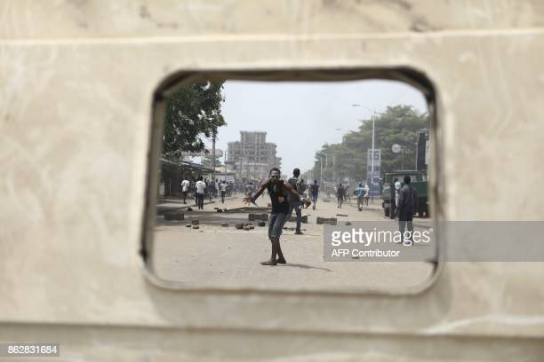 TOPSHOT A protester reacts as opposition supporters erect makeshift barricades and block roads in Lome on October 18 2017 Protesters erected...
