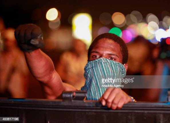 A protester reacts during a demonstration on August 18 2014 for Michael Brown who was killed by a police officer on August 9 in Ferguson United...