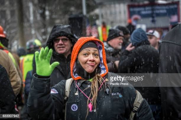A protester reacts on the camera Over 30000 members of New York City's Building Trades walked off their jobs to rally outside of City Hall calling...