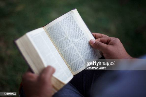 A protester reads the Bible before the start of a vigil for those who oppose Arizona's Immigration Law SB 1070 at the Arizona state Capitol April 25...