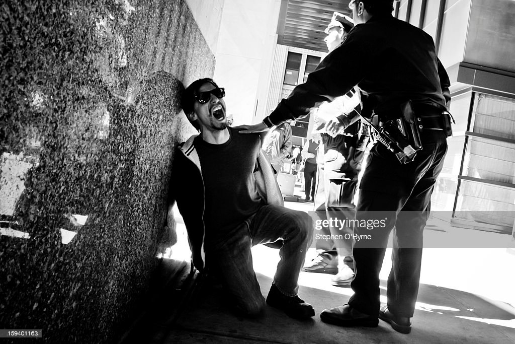 CONTENT] A protester screaming while being detained during an OccupyWallStreet march.
