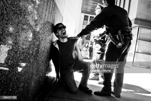 CONTENT] A protester screaming while being detained during an OccupyWallStreet march