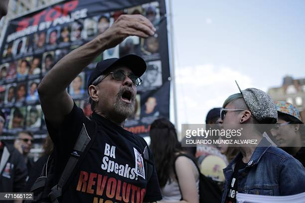 A protester shouts slogans against police brutality during a rally April 29 2015 at Union Square in New York held in solidarity with demonstrators in...