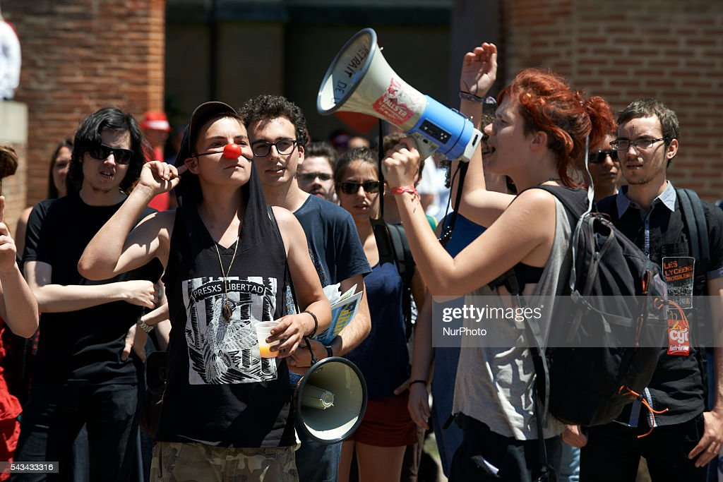 A protester shouts slogans at the end of a protest against the El-Khomri bill on labour reforms the day the bill go through the Senate. They also protest against the use of article 49.3 which bypass the Parliament . Toulouse. France. June 28th, 2016.