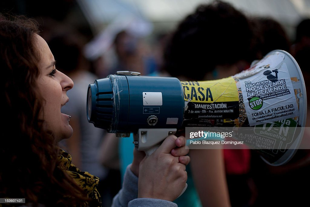A protester shouts slogans during a demonstration by students protesting against education cuts at Puerta del Sol on October 11, 2012 in Madrid, Spain. Sticker reads 'Education is not mean to be sold, it is mean to be defend it'. Ratings agency Standard & Poor's has cut Spain's credit rating down to BBB-. The Spanish government has already introduced spending cuts and tax increses in an attempt to ease the country's debt and reduce high unemployment levels. Spain's Minister of Economy Minister Luis de Guindos maintains that the country will not need to request a bailout.