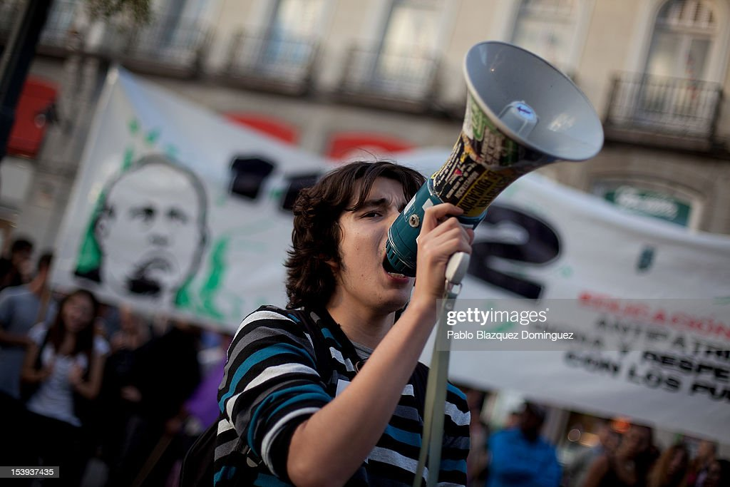 A protester shouts slogans during a demonstration by students protesting against education cuts at Puerta del Sol on October 11, 2012 in Madrid, Spain. Ratings agency Standard & Poor's has cut Spain's credit rating down to BBB-. The Spanish government has already introduced spending cuts and tax increses in an attempt to ease the country's debt and reduce high unemployment levels. Spain's Minister of Economy Minister Luis de Guindos maintains that the country will not need to request a bailout.