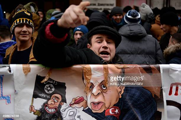 A protester shouts slogans during a demonstration in front of the Turkish embassy in Moscow on November 25 2015 Several hundred young activists on...