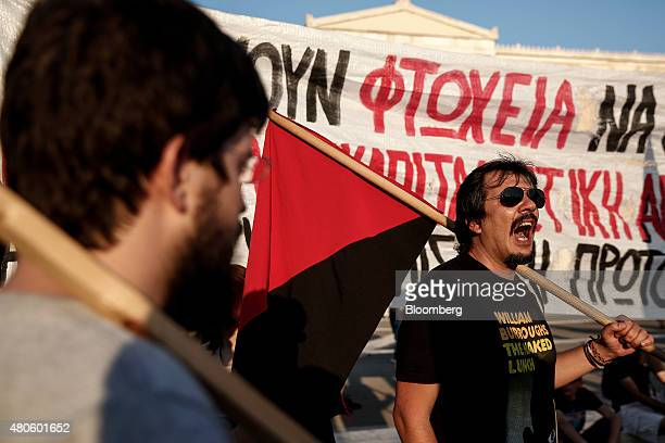 A protester shouts slogans during an antiEuropean Union rally outside the parliament in Athens Greece on Monday July 13 2015 Greece has been in...