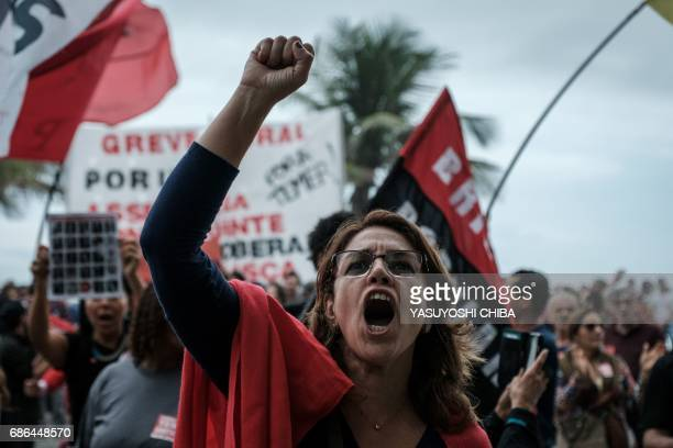 A protester shouts slogans in front of the house of lower house speaker Rodrigo Maia who would initially take over the presidency if President Michel...