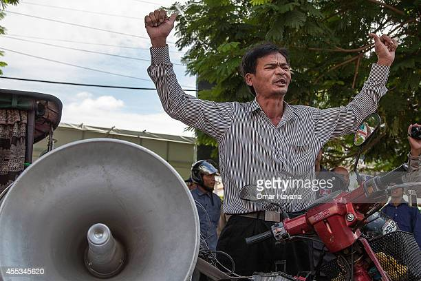 A protester shouts slogans to police forces that impede access to a planned hunger strike in front of the Chinese Embassy on September 13 2014 in...