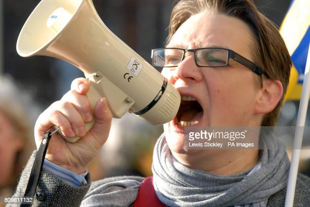 A protester shouts through a megaphone during the multiunion march through central Nottingham