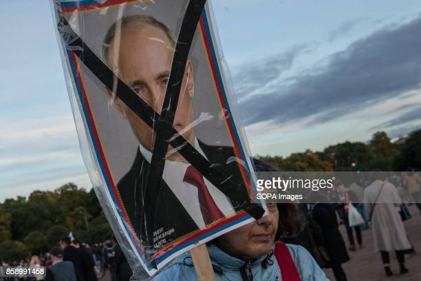 Protester show a banner saying 'no' to Russian President Vladimir Putin during an unauthorized rally The President of Russia Vladimir Putin...
