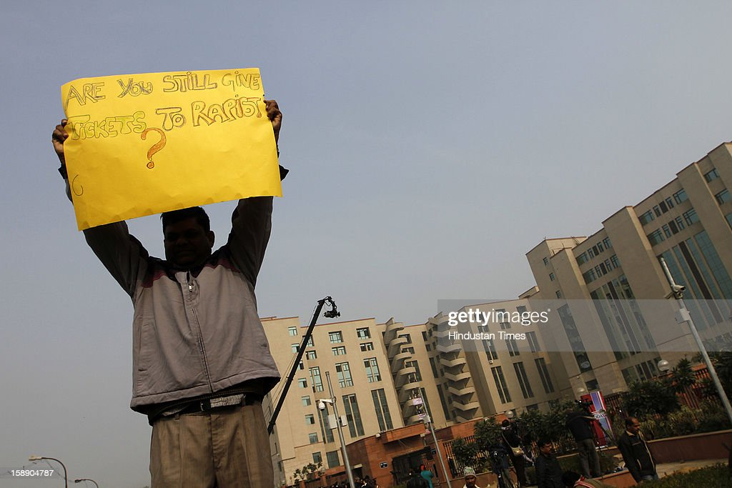 A protester showing poster outside newly inaugurated fast track court at Saket District court where police were preparing to file rape and murder charges against a group of men accused of sexually assaulting a 23-year-old university student for hours on a moving bus on January 3, 2013 in New Delhi, India.