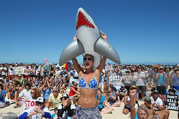 A protester shows her support during a sharkculling policy protest at Cottesloe Beach on February 1 2014 in Perth Australia The Western Australian...
