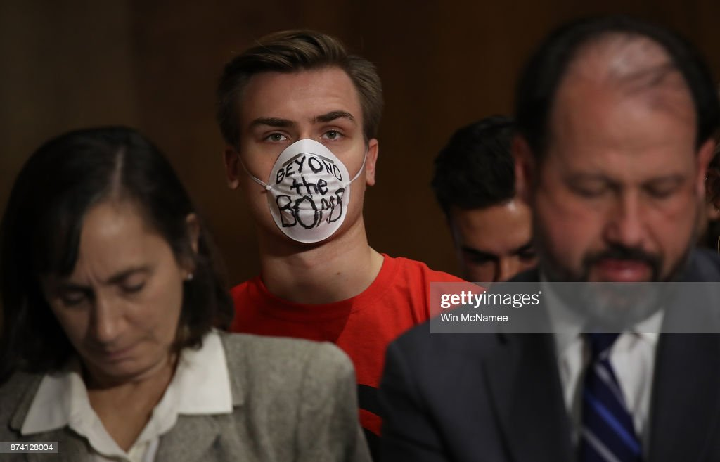 A protester sits in the audience during a Senate Foreign Relations Committee hearing November 14, 2017 in Washington, DC. The committee heard testimony on the 'Authority to Order the Use of Nuclear Weapons.'