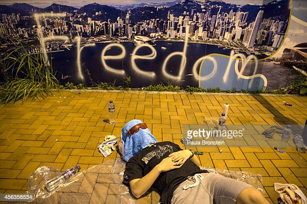 A protester sleeps on the streets outside the Hong Kong Government Complex at sunrise on September 30 2014 in Hong Kong Hong Kong Thousands of pro...