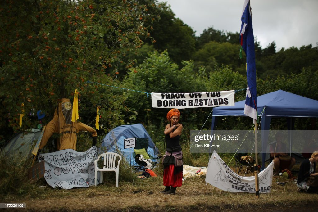 A protester stands beside the road outside the entrance gate of a drill site operated by Cuadrilla Resources Ltd on August 2 2013 in Crawley West...