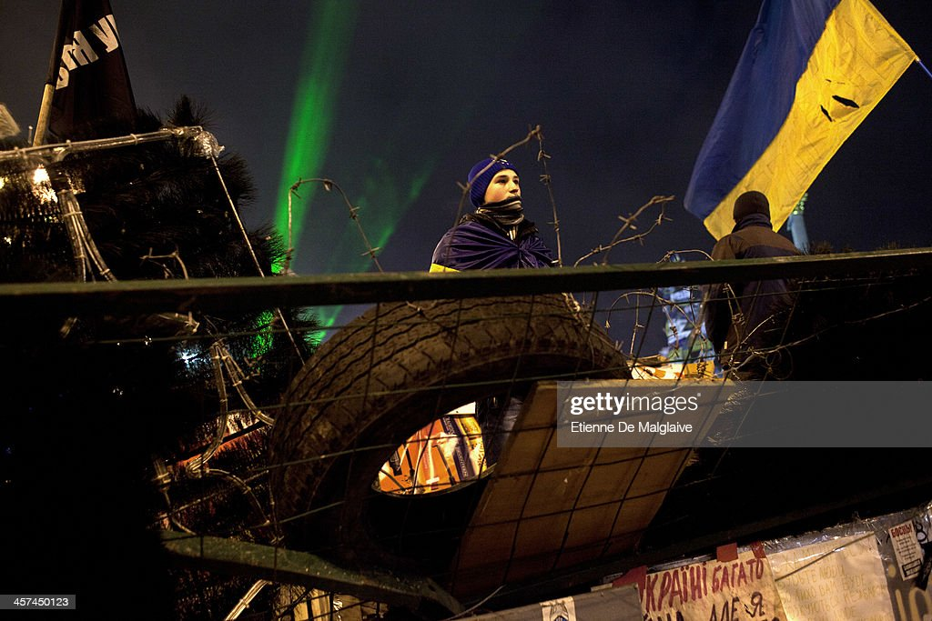 A protester stands guard on night watch at a barricade blocking Independance Square after it was announced that Ukrainian President Viktor Yanukovych agreed to receive major economic assistance from Russia, on December 17, 2013 in Kiev, Ukraine. Thousands of protesters have taken to the streets since Ukrainian president Viktor Yanukovych announced a decision to suspend a trade and partnership agreement with the European Union and raised concerns that the nation could be poised to enter a customs union with Russia.