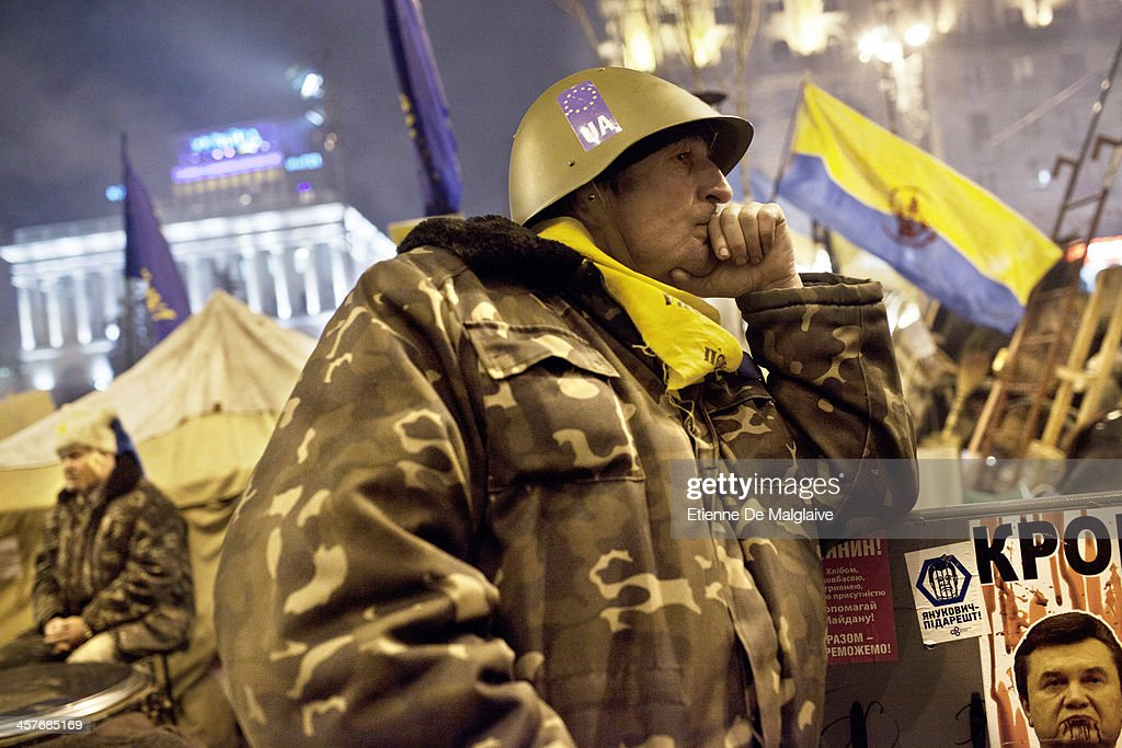 A protester stands guard on night watch at a barricade blocking Independance Square the day it was announced that Ukrainian President Viktor Yanukovych agreed to receive major economic assistance from Russia, on December 18, 2013 in Kiev, Ukraine. Thousands of protesters have taken to the streets since Ukrainian president Viktor Yanukovych announced a decision to suspend a trade and partnership agreement with the European Union and raised concerns that the nation could be poised to enter a customs union with Russia.