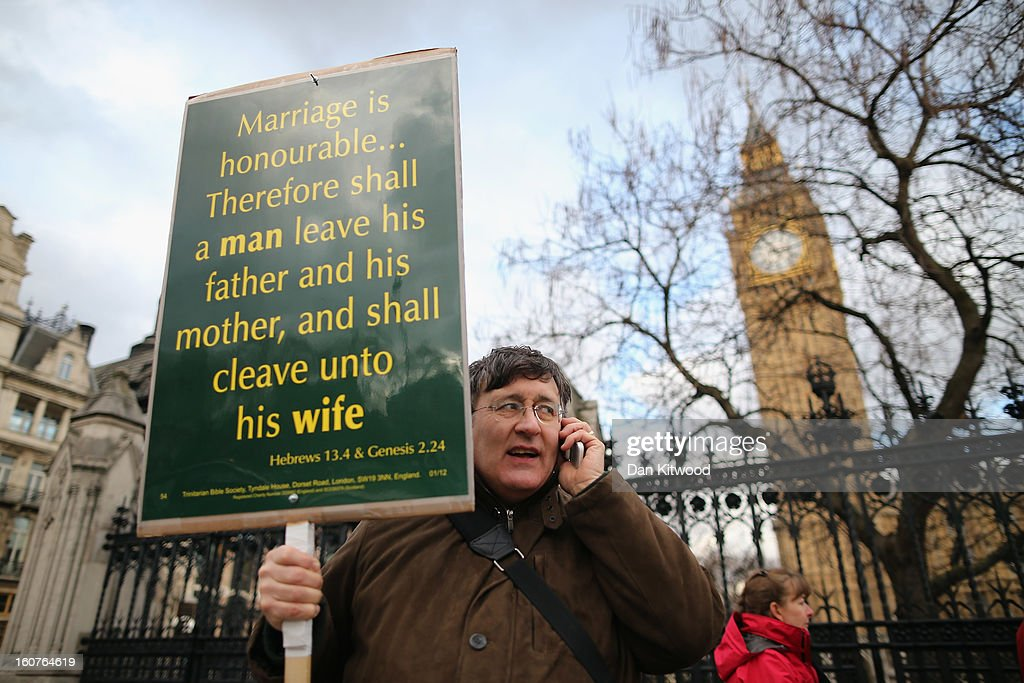 A protester stands in front of Parliament holding a placard with quotes from the Bible on February 5, 2013 in London, England. Later Parliament will hold a vote on whether to allow homosexual couples to marry.