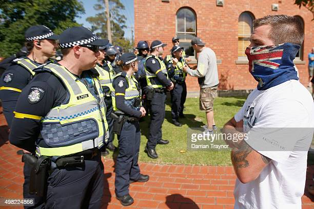 A protester stares at police during a Reclaim Australia rally held in Melton on November 22 2015 in Melbourne Australia Protestors gathered near the...