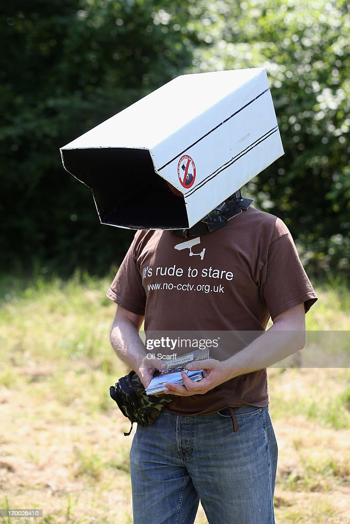 Protester Steve Jolly, from the organisation 'No CCTV', wears a cardboard replica of a CCTV camera on his head in the protester encampment outside The Grove hotel, which is hosting the annual Bilderberg conference, on June 6, 2013 in Watford, England. The traditionally secretive conference, which has taken place since 1954, is expected to be attended by politicians, bank bosses, billionaires, businessman and European royalty.