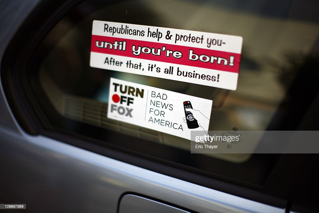 Protester stickers are seen on a car at the annual shareholder meeting of News Corp at Fox Studios October 21, 2011 in Century City, California. Protesters are demonstrating against Fox and News Corp's for what they see as one-sided reporting practices.