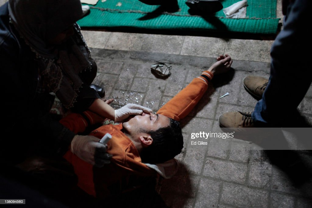 A protester suffering from the effects of tear gas inhalation is treated in a triage unit February 2 2012 in Cairo Egypt The protest follows the...