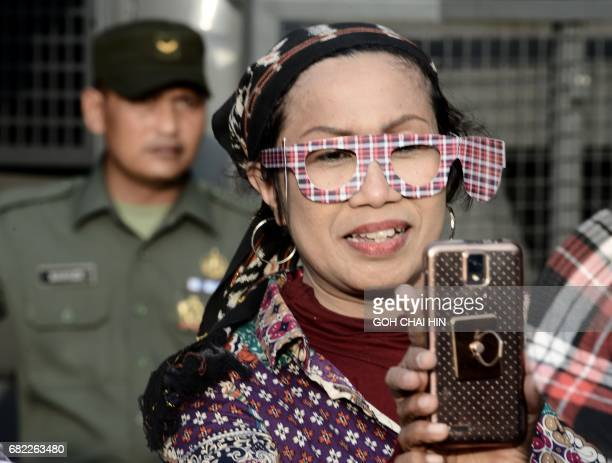 A protester takes a selfie outside the Indonesian High Court building in Jakarta on May 12 to demand the release of Jakarta's governor Basuki Tjahaja...