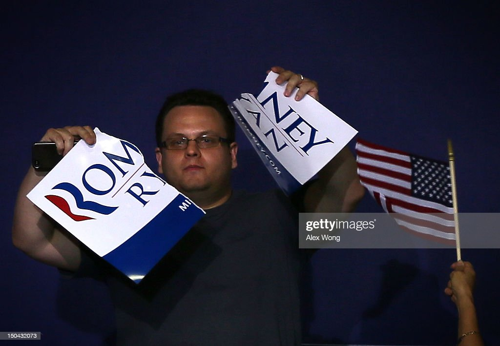 A protester tears a Romney-Ryan campaign sign in half as Republican U.S. Vice Presidential candidate Rep. Paul Ryan (R-WI) campaigns at a rally at West Springfield High School August 17, 2012 in Springfield, Virginia. Rep. Ryan continued to campaign After being named former Massachusetts Gov. Mitt Romney's choice for Vice President.