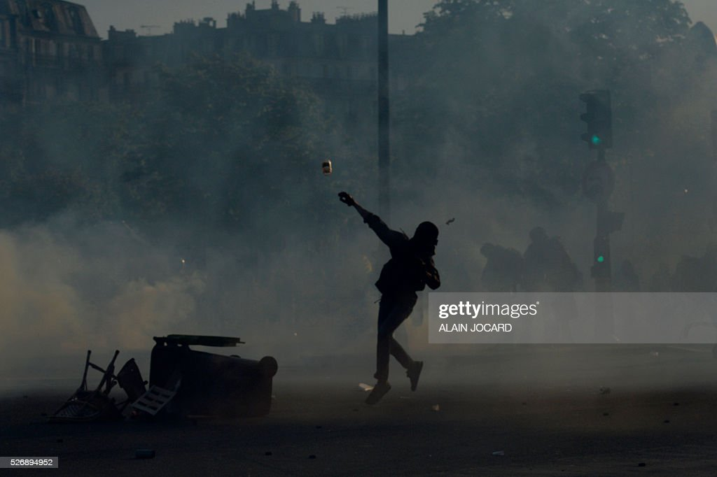 A protester throws a projectile during clashes with police at the traditional May Day demonstration in Paris on May 1, 2016.