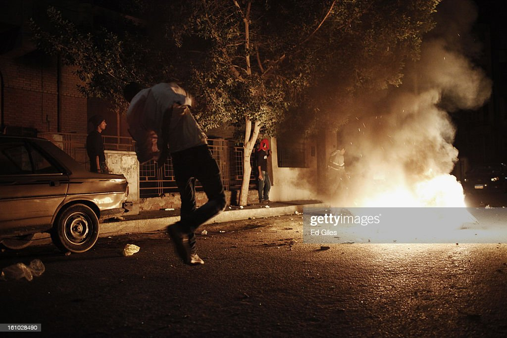 A protester throws a rock at nearby Egyptian riot police during violent protests near the Presidential Palace in Heliopolis on February 8, 2013, in Cairo, Egypt. Protests continued across Egypt against President Morsi and the Muslim Brotherhood two weeks after the second anniversary of the Egyptian Revolution that overthrew former President Hosni Mubarak on January 25, 2011.(Photo by Ed Giles/Getty Images).