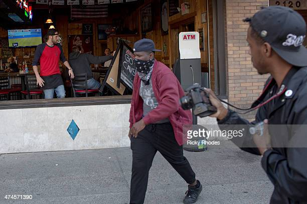 A protester throws a sign at a patron at Harry Buffal on E 4th St during demonstrations in reaction to Cleveland police officer Michael Brelo being...
