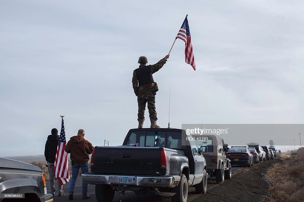 Protester Tom Wagner shows his support at the Malheur Wildlife Refuge Headquarters near Burns, Oregon, on February 11, 2016. The FBI surrounded the last protesters holed up at a federal wildlife refuge in Oregon amid reports they will surrender on Thursday, suggesting the weeks-long armed siege is approaching a climax. / AFP / Rob Kerr