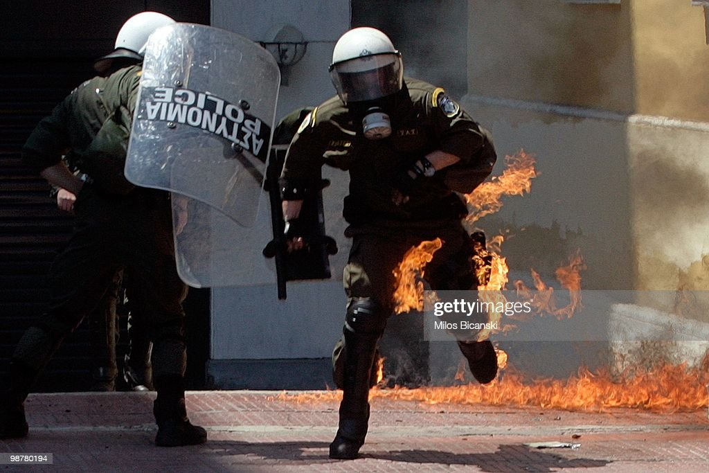 A protester uses molotov cocktails against riot police during May Day protests on May 1, 2010 in Athens, Greece. Thousands of protesters gathered in Athens and other Greek cities to participate in May Day rallies, angered by the harsh austerity measures demanded by the EU. Reports suggest that the 45 billion euros ($60 billion) already pledged by the International Monetary Fund and European Union will be insufficient to tackle Greece's mounting debt crisis.