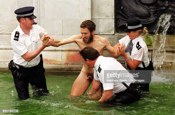 Protester Vincent Bethell outside Buckingham Palace demonstrated for his right to be nude in public and was escorted by police officers from the...