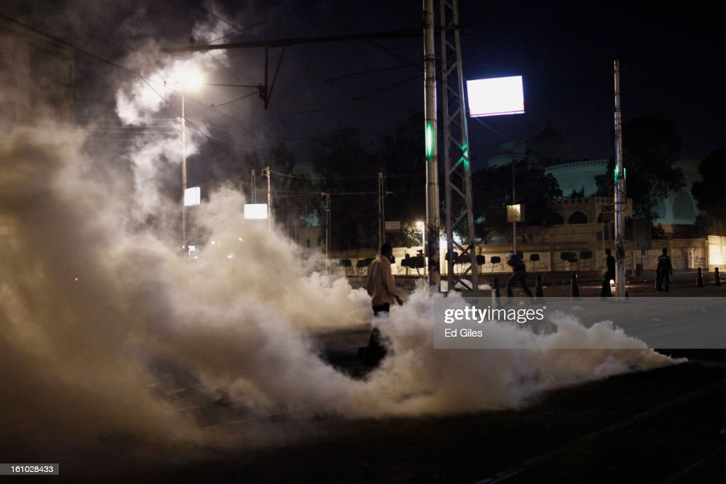A protester walks through a cloud of tear gas fired by Egyptian riot police during violent protests at the Presidential Palace in Heliopolis on February 8, 2013, in Cairo, Egypt. Protests continued across Egypt against President Morsi and the Muslim Brotherhood two weeks after the second anniversary of the Egyptian Revolution that overthrew former President Hosni Mubarak on January 25, 2011.(Photo by Ed Giles/Getty Images).