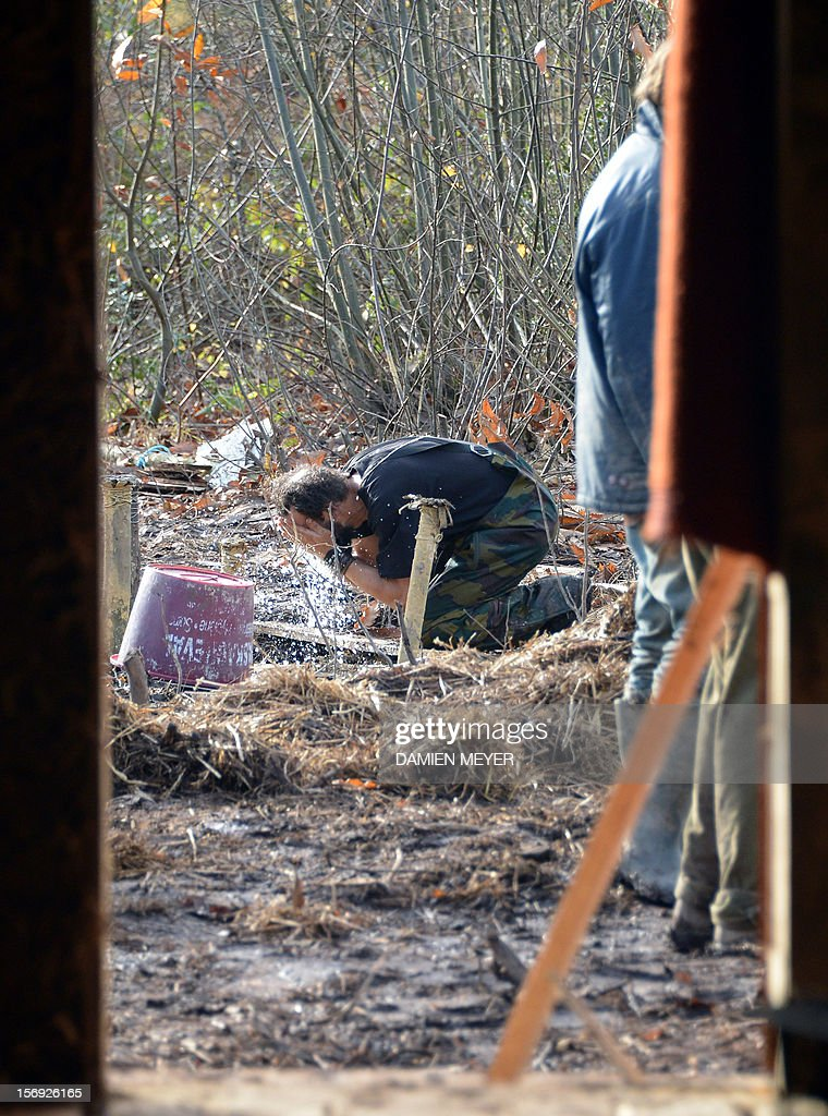 A protester washes his face after re-occupying a protected swampland on November 25, 2012 in Notre-Dame-des-Landes, near Nantes in western France, one day after squatters' eviction and clashes with anti-riot policemen. The airport, which is scheduled to replace the current airport at Nantes in 2017, is a pet project of Socialist Prime Minister Jean-Marc Ayrault, who was the city's mayor from 1989 until this year.