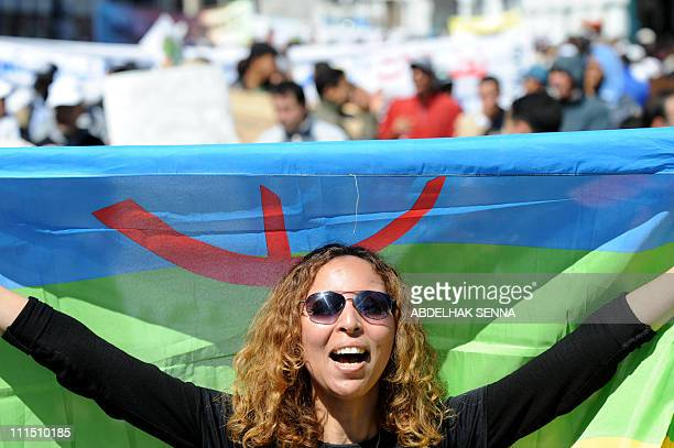A protester waves a berbere flag during a demonstration on March 20 2011 in Rabat calling for further democratic reforms and social justice More than...