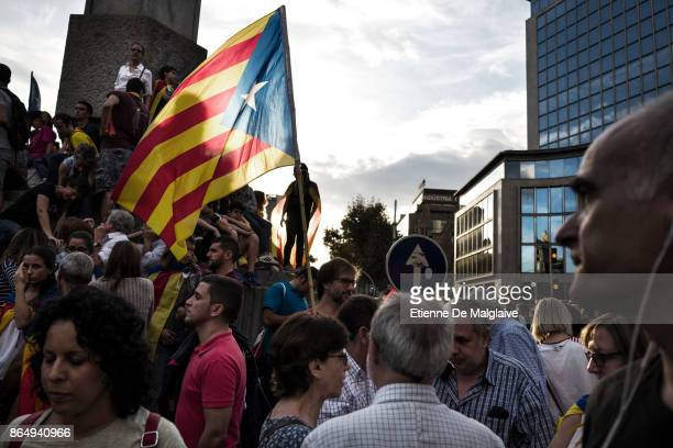 A protester waves a Catalan flag during a rally to demand the release of imprisoned Catalan leaders Jordi Sanchez and Jordi Cuixart at a...