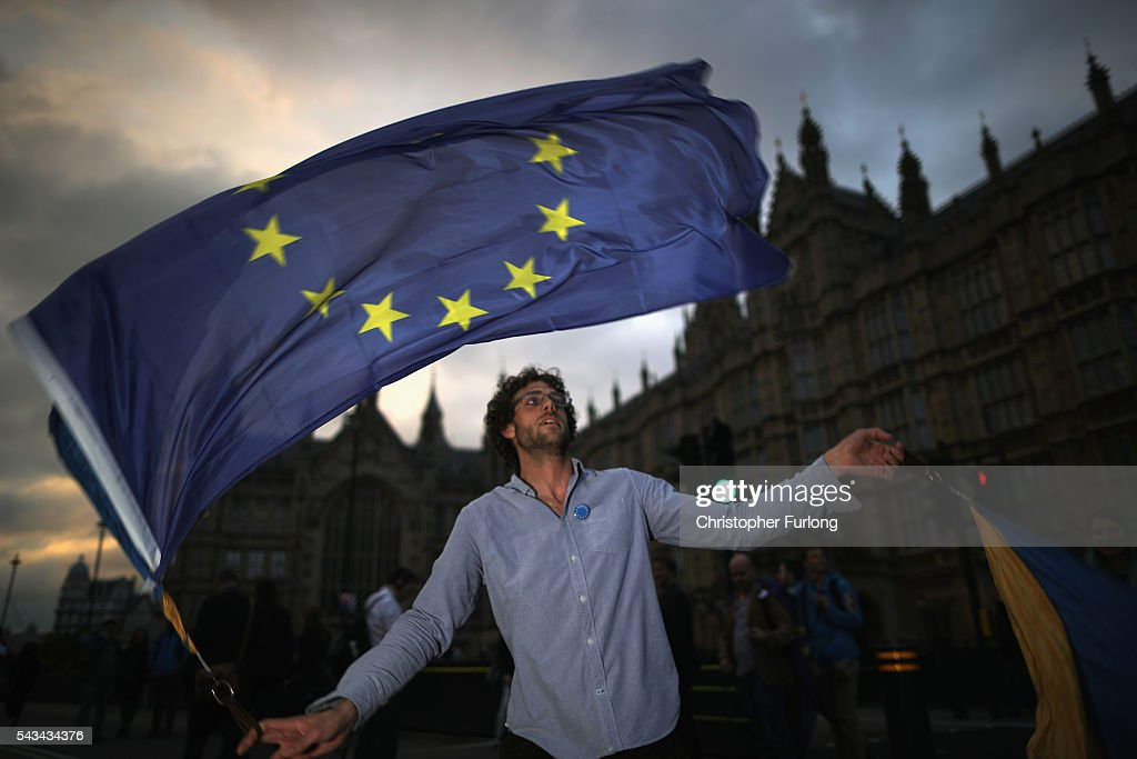 A protester waves an EU flag in front of the Houses of Parliament as they demonstrate against the EU referendum result on June 28, 2016 in London, England. Up to 50,000 people were expected before the event was cancelled due to safety concerns. Early evening up to 2000 people have still converged on the square and then marched to Parliament to vent their anti-Brexit feelings.