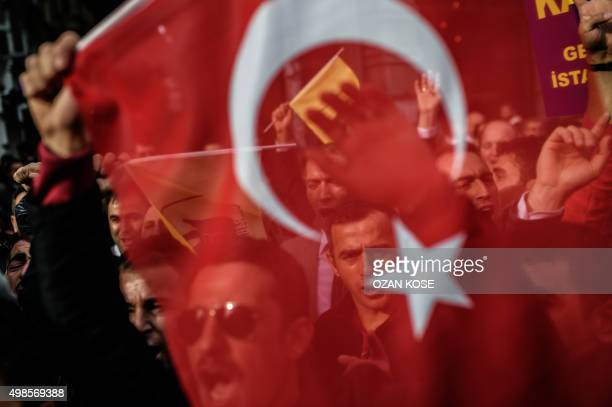 A protester waves Turkey's national flag as he and others shout slogans in front of the Russian Istanbul consulate during a demonstration against...