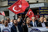 A protester waves Turkey's national flag while others shout slogans in front of the Russian Istanbul consulate during a demonstration against...