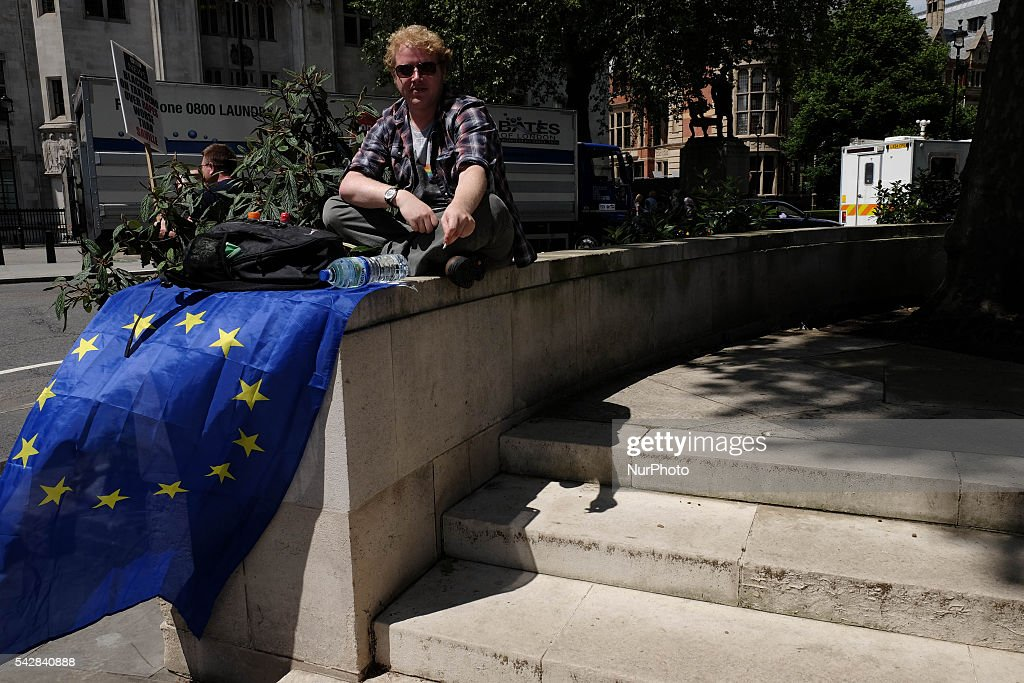 Protester waving an EU flag around Downing street, London, on 24 June 206, in the aftermath of 'Brext'