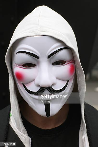 Protester wearing a Guy Fawkes mask trademark of the Anonymous movement and based on a character in the film V for Vendetta France