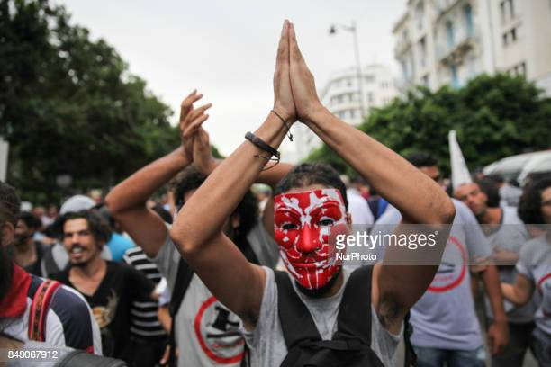 A protester wearing a mask applauds during a march held under the slogan firmness against the mafia regime by the movement quotI don't forgivequot on...