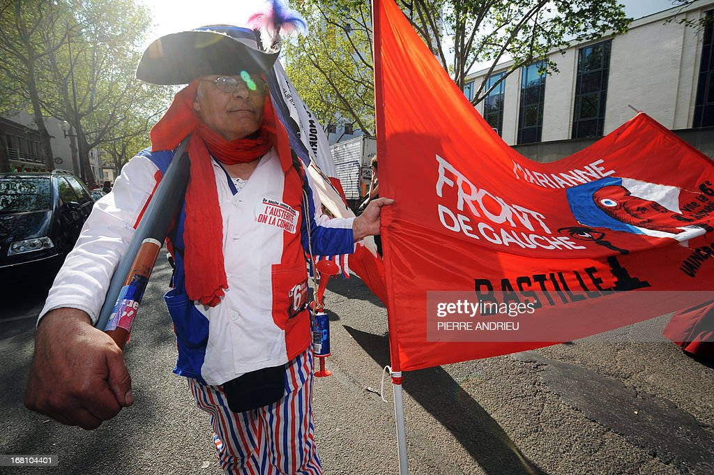 A protester wearing French national colours takes part in a demonstration on May 5, 2013 in Paris, called by Jean-Luc Melenchon, leader of Front de Gauche (Left Front) left wing party, to protest 'against the austerity, against the finance and to ask for a Sixth Republic'. When France's president Francois Hollande swept to power on May 2012 on a wave of discontent, he could hardly have imagined that a year later he would be the most unpopular president in modern French history.