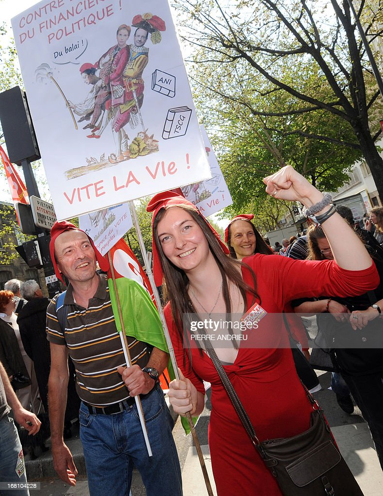 Protester wearing phrygian caps take part in a demonstration on May 5, 2013 in Paris, called by Jean-Luc Melenchon, leader of Front de Gauche (Left Front) left wing party, to protest 'against the austerity, against the finance and to ask for a Sixth Republic'. When France's president Francois Hollande swept to power on May 2012 on a wave of discontent, he could hardly have imagined that a year later he would be the most unpopular president in modern French history.